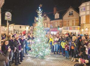 Attendees watch as Twyford turn on Christmas tree lights