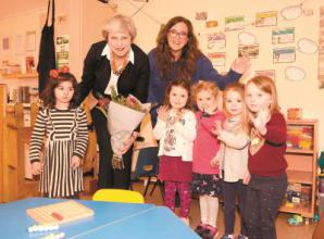 Theresa May visits Happy Hours Pre-School following their 50th anniversary