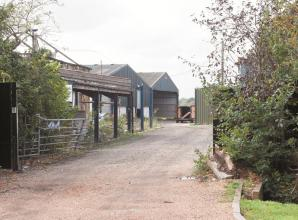 Residents object to farmland switching to business site